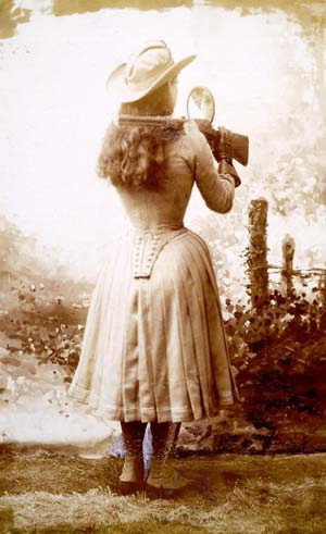Expert Markswoman Annie Oakley performing her famous mirror trick