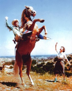 Roy Rogers on his golden palomino Trigger, with wife and costar Dale Evans