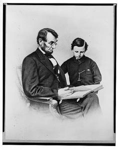 "President Lincoln and son ""Tad"" (Thomas) in a February 9, 1864 photograph by Anthony Berger of the Brady Studio."
