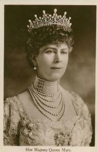 "Shown in the photograph is Queen Mary (1867-1953), grandmother of Queen Elizabeth II. Queen Mary was a manic collector of jewelry and other fine pieces. During the reign of her husband, King George V (1865-1936), she vastly expanded the Royal Collection, often from the houses of friends. Mary is shown here wearing ""the Girls of Great Britain and Ireland Tiara"" which is also referred to as ""Granny's Tiara,"" which she gave to Elizabeth in 1947, the year she married Prince Philip."