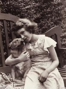 Princess Elizabeth, age 9 or 10, comforts her corgi Dookie, 1936