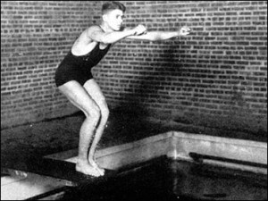 Ronald Reagan stands on the diving board in the Little 19 (Illinois private colleges) swim meet held at St. Viator in this March 22, 1930 file photo.