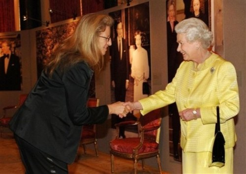In this March 2007 photo, Britain's Queen Elizabeth II greets American photographer Annie Leibowitz at a reception prior to their photo shoot. Notice that the Queen has her black Launer purse on her arm.
