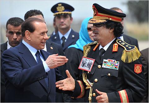 Italian Prime Minister Berlusconi greets Libyan leader Colonel Muammar Qaddafi, June 10, 2009, in Rome.