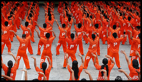 "Filipino Prisoners dance to pop tunes such as ""Thriller"" and ""Soulja Boy"" as part of their physical fitness"