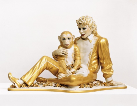 "Jeff Koons' porcelain and gold lifesize sculpture, ""Michael Jackson and Bubbles,"" is on exhibit in Versailles, France."