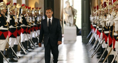 "French President Nicolas Sarkost arrives at Versailles Palace on June 22, 2009, to address Parliament. H condemned the use of the burqa in France, calling it an unacceptable symbol of ""enslavement."""