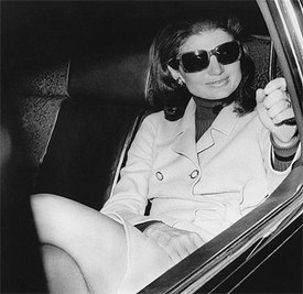 Jackie looking good in a trench coat. What is the Jackie O look? classic and refined