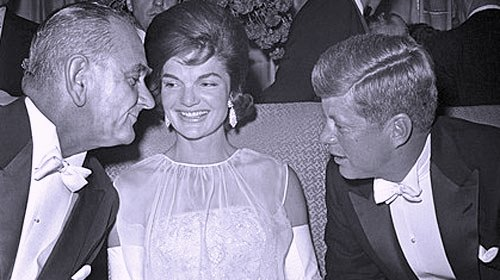 First Lady Jackie Kennedy at President John F. Kennedy's 1961 inauguration. Seen here with, at left, then-Vice President Lyndon B. Johnson and, at right, her husband, President Kennedy.