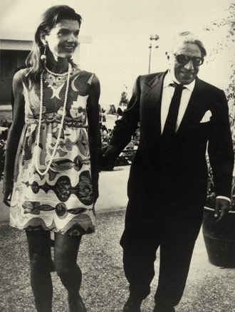 Jackie and Ari Onassis in 1969, Jackie, in a festive summer print, and husband Aristotle Onassis leave an Athens nightclub at 7 a.m. after celebrating Jackie's 40th birthday.