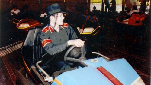 Michael Jackson in a bumper car in the amusement park at his Neverland Ranch, 1994
