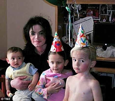 Michael Jackson with children, l to r: Prince Michael II (Blanket), Paris, and Prince Michael