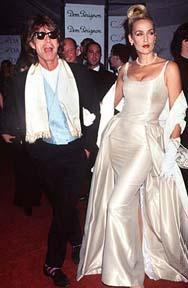 "Mick Jagger and wife Jerry Hall. Hall filed for divorce from Jagger in 1992, calling him Jagger is a ""lying, cheating, no-good slimeball."" Jerry Hall is a Texas native."