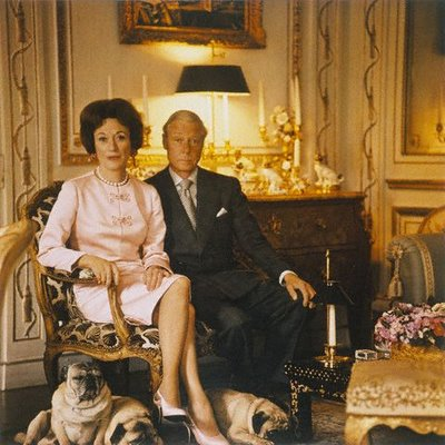 the Duke and Duchess of Windsor at home with their precious pug dogs. The Duchess, the former Wallis Warfield Simpson, often appeared in her stylish best in public with a pug tucked under one arm. It became a fashion trend - to carry a dog around with you when away from home.