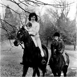 "First Lady Jackie Kennedy riding horses with her children at their Middleburg, Virginia, retreat ""Glen Ora."" Jackie grew up surrounded by horses and was an accomplished equestrian. President John Kennedy did not share her passion for horse shows and riding. He was allergic to horse fur. November 19, 1962."