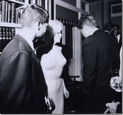 "Bobby Kennedy, Marilyn Monroe, and President John Kennedy gather following Monroe's iconic performance of ""Happy Birthday, Mr. President,"" at Madison Square Garden, May 19, 1962. Marilyn is still wearing the gown she wore in the performance which she referred to as ""skin and beads."""