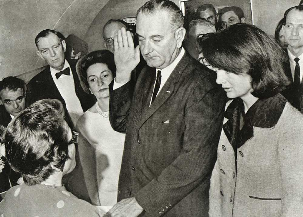 jackie kennedy bloody suit. LBJ swearing in, with Jackie