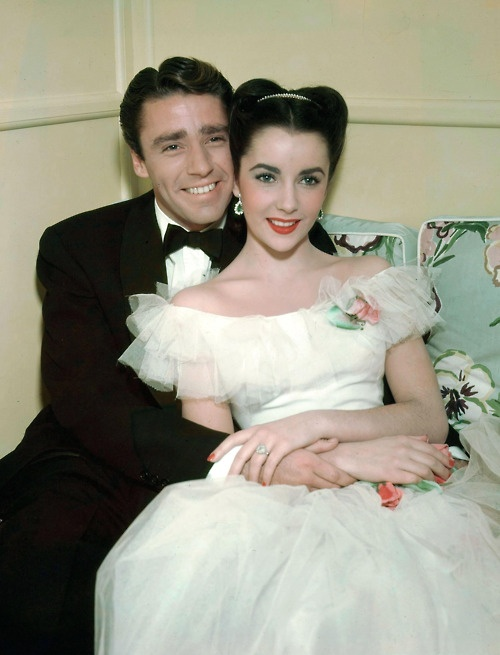 """Peter Lawford and Elizabeth Taylor in this publicity shot for """"Julia Misbehaves"""" (1948). In this unretouched 1950 publicity photo, one can see La Liz's arms were covered in a dark and velvety down, in keeping with her being a beautiful brunette."""