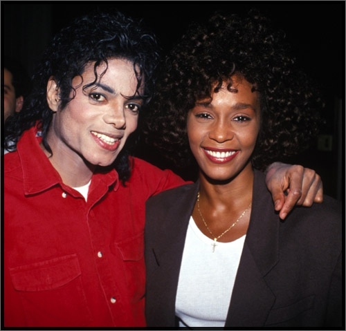 Michael jackson wraps his arms around whitney houston