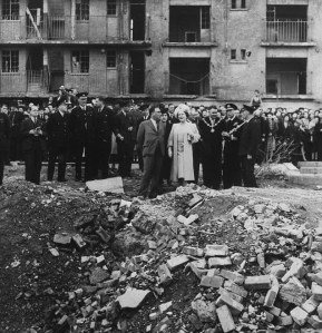 Queen Elizabeth and King George VI of Great Britain stop at Vallence Road, Stepney, in the East End, London, to examine the debris following an air raid in the Second World War. October 4, 1945