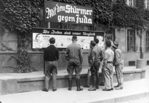 1933 Germany. Germans read issues of anti-Semitic propaganda newspaper, Der Stürmer, published by Nazi agitator Julius Streicher