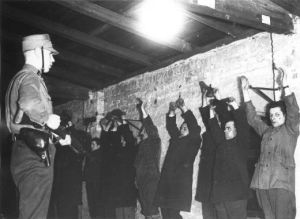 """February 1, 1933. One day after Hitler becomes Chancellor, the Sturmabteilung (SA), the Nazi paramilitary group known as """"the brownshirts"""" round up suspected Communists."""