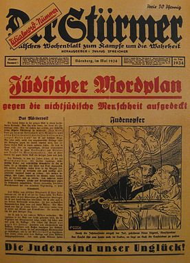 "May 1934 issue of Der Stürmer, a weekly Nazi propaganda newspaper owned by Julius Streicher. This specific cover issue is notorious as an example of the anti-Semitic propaganda style of Der Stürmer. It invokes the infamous ""blood libel against the Jews"", specifically the allegation that Jews were killing German Christian children and using their blood in religious rituals. The banner across the bottom of the page, ""Die Juden sind unser Ungluck,' means ""The Jews are our misfortune."""