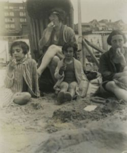 1934, Amsterdam. Margot, Anne, and their mother Edith Frank on the beach with Mrs. Schneider (back)