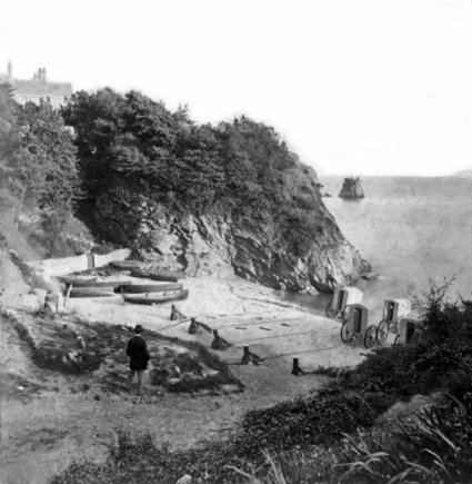 The Ladies' Bathing Cove, Torquay England, undated. Note the bathing machines at the shoreline.