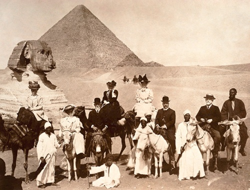 British tourists pose in about 1910 at Giza outside Cairo, the Sphinx over their shoulders. Agatha Christie, too, visited this spot in 1910 but was not as interested in Egyptology and archaeology then as she would be in later years.