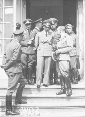 German propaganda minister Joseph Goebbels is shown at the entrance to Queen Wilhelmina's residence, the Noordeinde Palace in The Hague on Carnation Day. The nonviolent protest demonstration by the Dutch citizens greatly alarmed their German occupiers. Hitler was informed and the Nazis began their crackdown on Dutch life, liberty, and the pursuit of happiness.