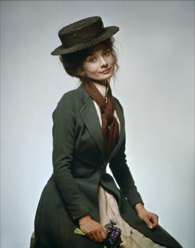 """Audrey Hepburn as Cockney flower seller in 1964 musical film, """"My Fair Lady."""" Julie Andrews had played the lead in the Broadway play but producer Jack Warner wanted Audrey Hepburn as Eliza Doolittle for his film. Warner's film was to cost him $5 million. Audrey was well-known, talented, and her films never lost money. He wanted Audrey, not Julie. It caused quite a flap in the movie industry, with many feeling Julie Andrews should have had the role. Julie Andrew was then cast as Mary Poppins. That year, Audrey was snubbed at the Academy Awards, not even being nominated for her """"My Fair Lady"""" performance. Julie Andrews won the Best Actress Oscar for """"Mary Poppins."""""""