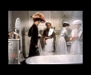 Mrs. Pearce prepares the bath for Eliza.
