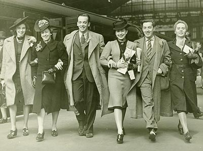 Members of the Sadler's Wells Ballet Company leave Victoria Station, London, for a tour of Holland, May 1940