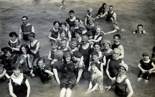 Here is a mixed group of bathers photographed in Eastbourne around 1906. Mixed bathing in England became widely accepted at about this time.