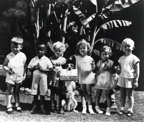 Shirley Temple (third from right) and her fellow castmates from Baby Burlesks in an ad for Baby Ruth candy bars, a stipulation in her contract with Educational Films Corporation. 1933/34