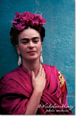 Frida Kahlo photographed by Nickolas Muray 1939. Friday wears ivory earrings given to her by artist Pablo Picasso.