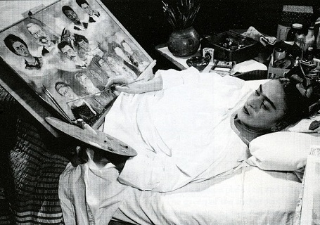 Frida Kahlo painting in bed. Undated photo
