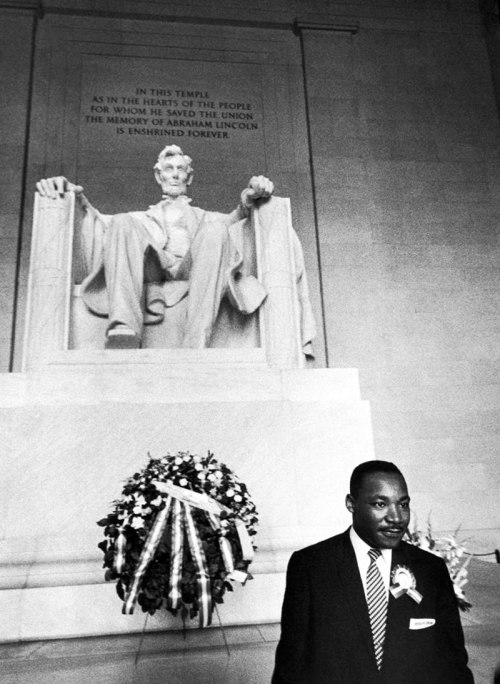 Dr. Martin Luther King, Jr. stands in front of the statue of President Abraham Lincoln at the Lincoln Memorial, Washington, D.C. ca. 1963