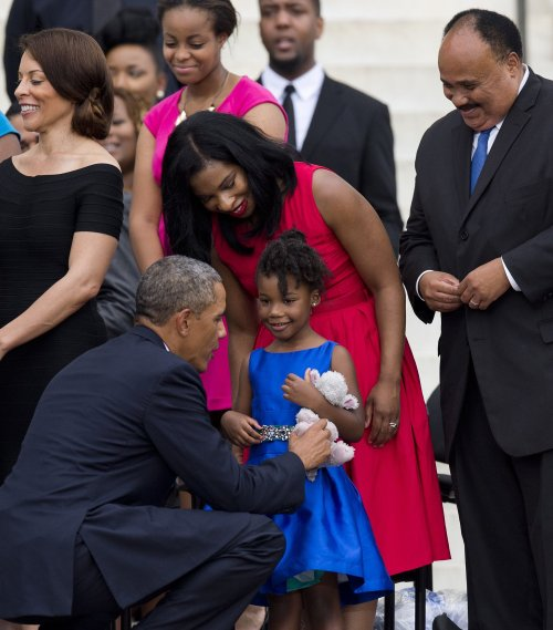 President Obama greets Yolanda King, age 5, Dr. Martin Luther King, Jr.'s granddaughter at the 50th Anniversary of the March on Washington. August 28, 2013. Credit; Getty Images