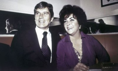John Warner and Elizabeth Taylor in her favorite purple pantsuit by Halston. 1977
