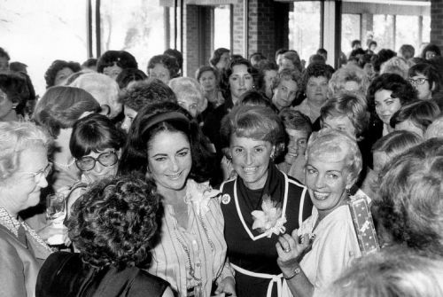 Twelve days before the U.S. Senate election,Republican women crowd around Elizabeth Taylor Warner at the Meadowbrook Country Club, Richmond. Va.  Oct. 26, 1978.