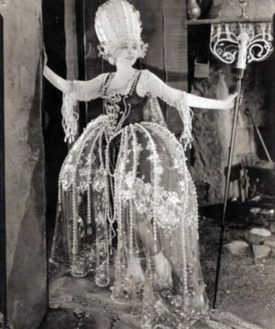 """Agnes Ayres stars in Cecil B. DeMille's 1921 film, """"Forbidden Fruit."""" In silent films, costume was an extremely important element. DeMille's films were always lavish extravaganzas."""