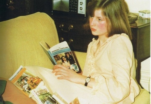 Lady Diana Spencer reads a romance novel by her favourite author, Barbara Cartland. Diana is probably 16. Photo ca. 1977