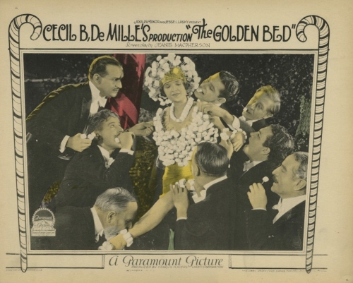 "The ""Candy Ball"" scene from Cecil B. DeMille's 1924 film, ""The Golden Bed."" Men surround women wearing marshmallow dresses, pull off the sweets, and eat them."
