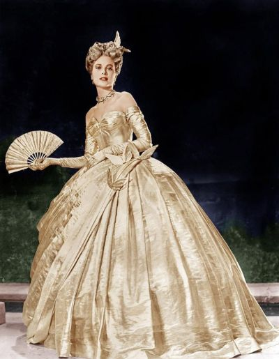 "As in sketch above, Grace Kelly wears masquerade gown in ""To Catch a Thief,"" 1955. Costumes by Edith Head."