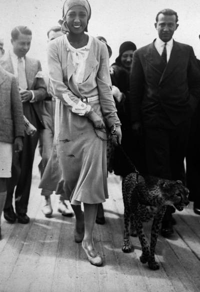 Heads turned when entertainer Josephine Baker took her pet cheetah Chiquita on a walk, sometimes down the Champs-Élysées in Paris. Ca. 1930