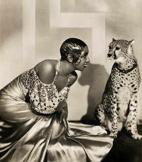 American entertainer Josephine Baker (1906-1936) often performed onstage in Paris nightclubs with pet cheetah Chiquita. Chiquita wore a diamond collar. Sometimes, during a performance, Chiquita would decide to jump off the stage and into the orchestra pit, causing quite a ruckus. Early 1930s. Courtesy of Victoria and Albert Museum.