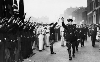 Oswald Mosley and his Blackshirts march to stir up hatred against British Jews and Communists. 1936