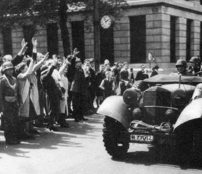 "In May 1940, the Nazis invaded the Netherlands. Sadly, there were Dutch citizens sympathetic to the Nazi Party. Here they provide the invading troops with the Nazi salute. These Nazi sympathizers were called ""NSBers."" They were collaborators and were always spying for the Nazis. May 1940"